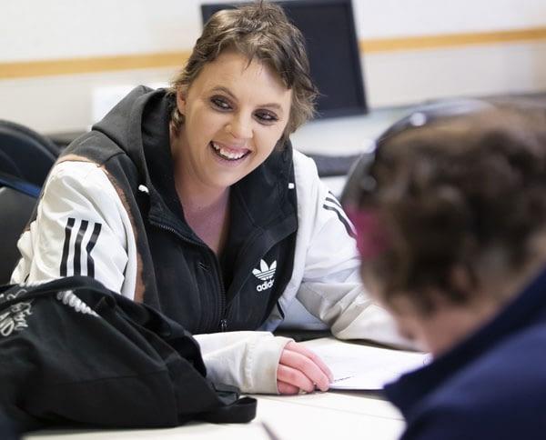 Long shot of woman in classroom